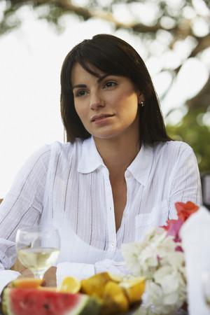 South American woman drinking wine Stockfoto