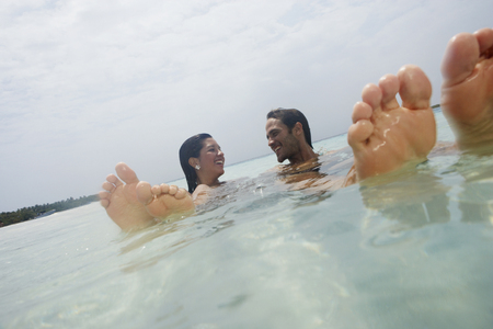 South American couple in water