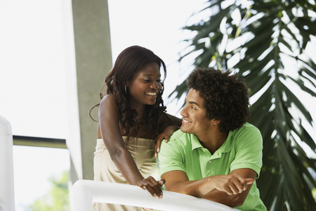 South American couple smiling at each other Stock Photo