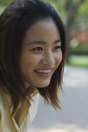 Confident Chinese woman smiling