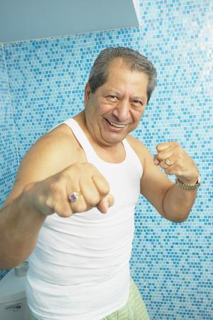 Hispanic man boxing in bathroom