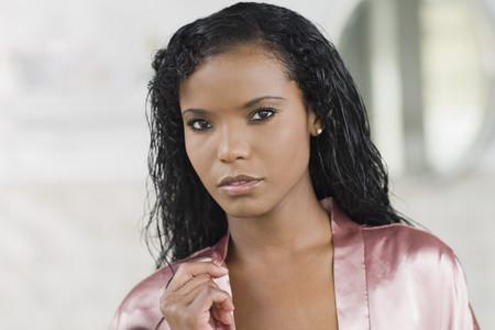 Panamanian woman in silk robe looking serious Stock Photo