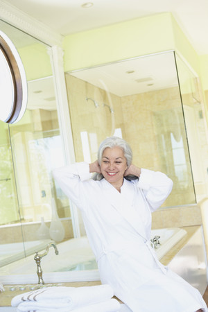 Smiling woman wearing bathrobe in spa