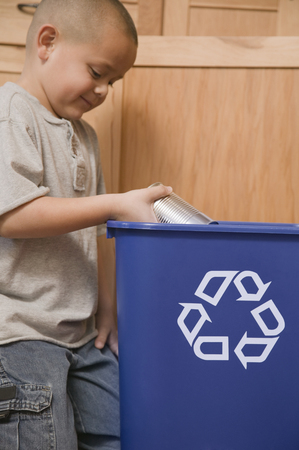 Hispanic boy recycling tin can Stock Photo