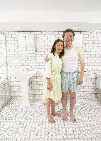 Asian husband and wife in bathroom together