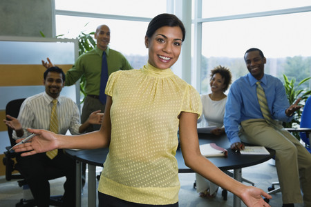Multi-ethnic business people gesturing in office
