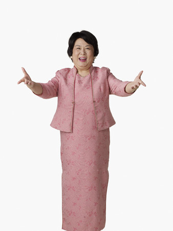Confident Asian woman with arms outstretched