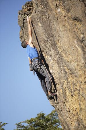 Argentinean man rock climbing Reklamní fotografie