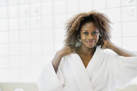 Confident African woman in bathrobe