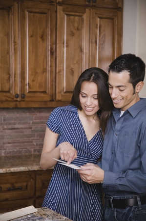 Hispanic couple making selection for home improvement project