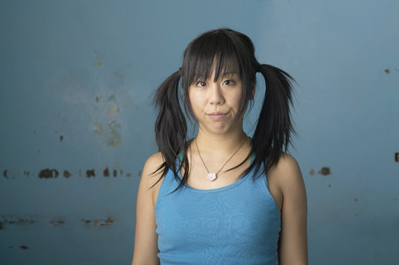 Mixed-race woman with pigtails making silly face