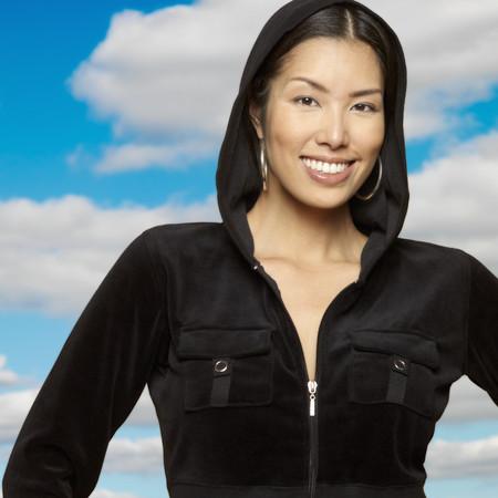 Portrait of Asian woman wearing hooded sweatshirt