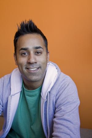 Smiling mixed race man