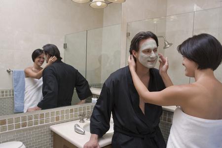 Hispanic couple in bathroom