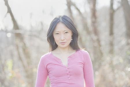 Serious Asian woman outdoors Banco de Imagens