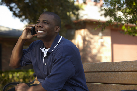 Black man talking on cell phone Stock Photo