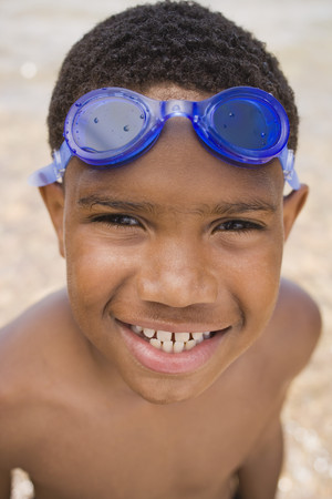 Smiling African boy with goggles
