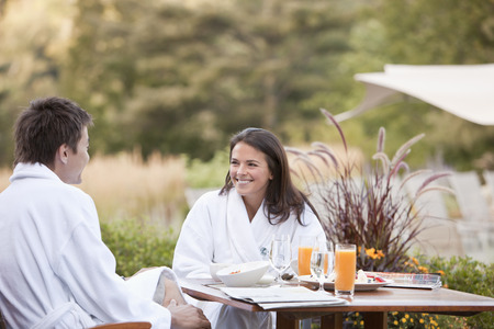 Couple enjoying breakfast on outdoor patio