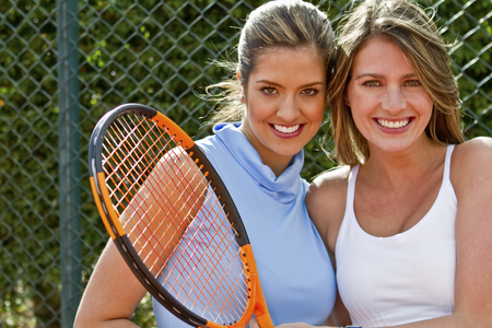 Hispanic women standing together with tennis racquet Stock Photo