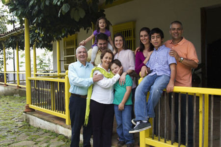 Family standing on porch together