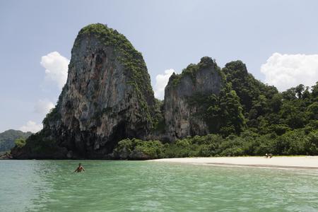 Person wading on ocean near beach 版權商用圖片