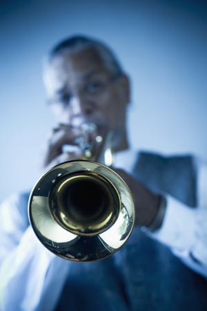 Musician playing trumpet Imagens