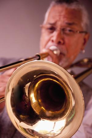 Musician playing trombone 写真素材