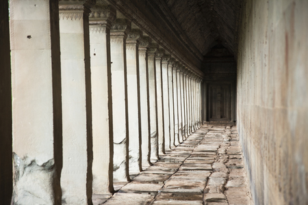 Pillars in Angkor Wat temple Stock Photo