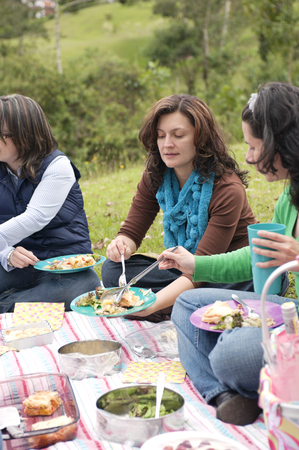 Hispanic woman enjoying picnic