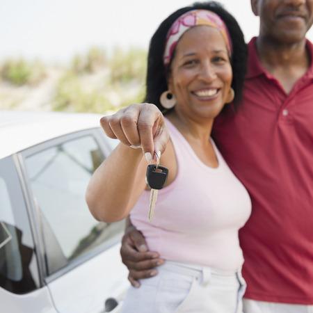 Black woman with husband holding car keys