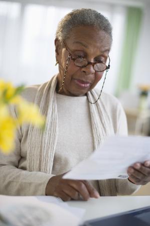 Black woman reading letter