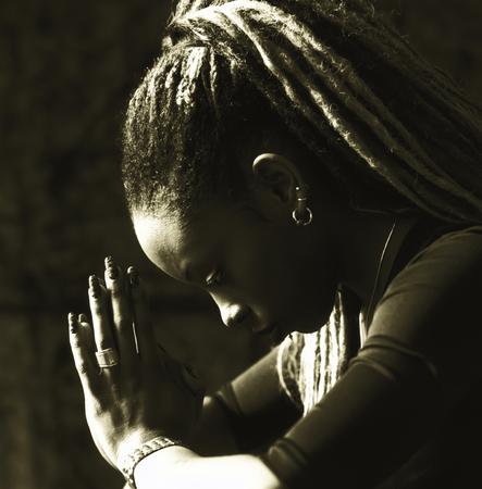 Serious woman praying