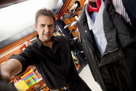 Hispanic man shopping for clothes in store