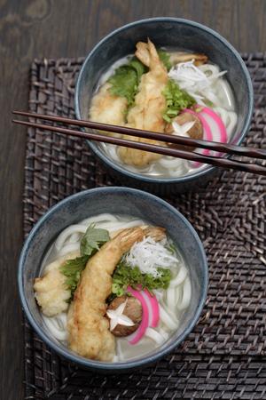 Udon noodle soup and tempura battered prawns