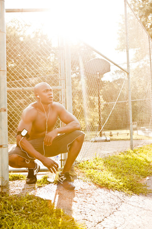 African American man relaxing after exercise