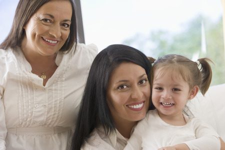 Hispanic grandmother, mother and daughter