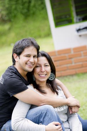 Hispanic couple sitting together Stock Photo
