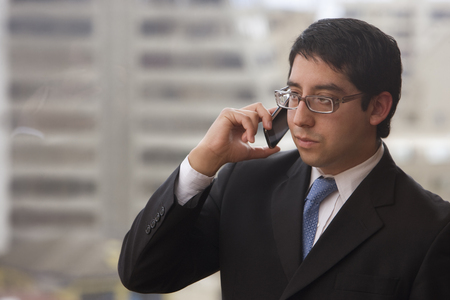 Chilean businessman talking on cell phone