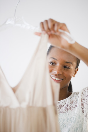 Black woman looking at dress Stock Photo