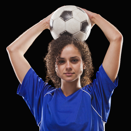 Caucasian soccer player holding ball Stock Photo
