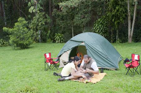 Hispanic couple camping together Stock Photo