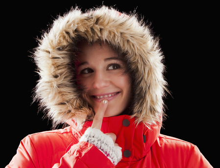 Caucasian woman wearing fur-hooded coat Stock Photo