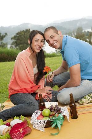 Hispanic couple having picnic together