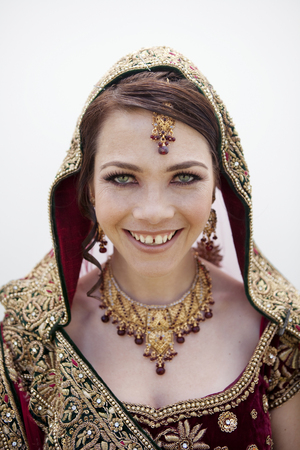 Caucasian woman in traditional Indian wedding clothing Reklamní fotografie