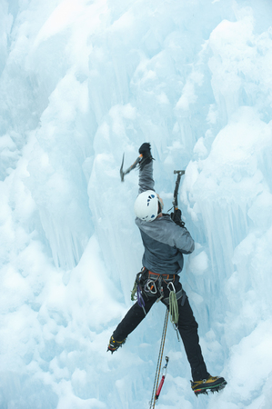 Caucasian man climbing ice Stock Photo