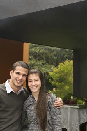 Smiling Hispanic couple hugging