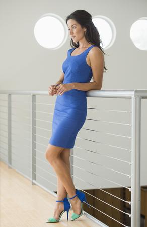 Hispanic woman leaning on railing Stock Photo - 107970894