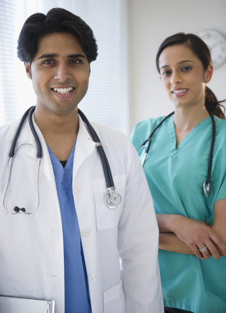 Smiling mixed race doctors Stock Photo