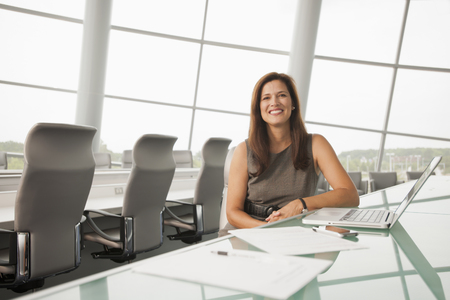 Caucasian businesswoman working in conference room 写真素材