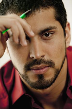 Close up of serious man with beard Imagens